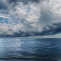 Dramatic sky over darken sea rain before Royalty Free Stock Photos