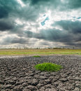 Dramatic sky over drought land and Royalty Free Stock Photo