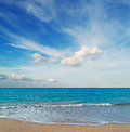 Dramatic sky in platamona frothy shore and scenic clouds sardinia Stock Photos
