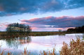 Dramatic sky at sunrise bu pond Royalty Free Stock Photography