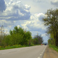 Dramatic spring sky and road