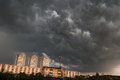 Dramatic stormy clouds over a city thailand Stock Photos