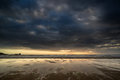 Dramatic stormy sky landscape reflected in low tide water on Rho Royalty Free Stock Photo