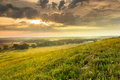 Dramatic sunrise over the kansas tallgrass prairie preserve national park a light fog and heavy dew fills valley as this warm Stock Images