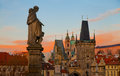 Dramatic sunrise view of the towers of mala strana from charles little quarter area in prague bridge blue and orange sky Royalty Free Stock Image