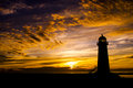 Dramatic Sunset and Lighthouse Stock Image
