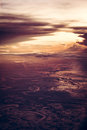 Dramatic sunset over the earth from the height in vintage style with epic sky.