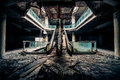 Dramatic view of damaged and abandoned building escalators in apocalyptic evil concept Stock Images