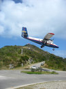 Dramatic Winair plane landing at St Barth airport Royalty Free Stock Photo