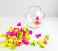 Draw lots small colorful paper pieces cut for randomly drawing in a glass transparent bowl Royalty Free Stock Image