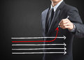Drawing arrows in different directions businessman Royalty Free Stock Photography