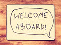 Drawing board with the phrase welcome aboard handwritten over wooden board filtered image Stock Photography