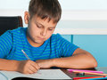 Drawing boy at the desk Royalty Free Stock Images