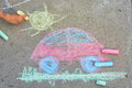 Drawing car child s hand is sunand grass using colorful chalks on asphalt Stock Images
