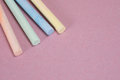 Drawing chalk sticks close up with pink copy space