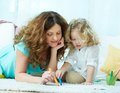 Drawing with daughter close up image of a lovely mom her little Stock Photography