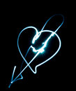 Drawing heart by flashlight in the air Royalty Free Stock Image