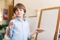 Drawing lesson portrait of a boy standing next to his easel a Royalty Free Stock Images
