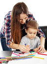 Drawing lessons young women helping a cute toddler boy with colorful pencils Royalty Free Stock Photos