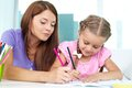 Drawing with mom mother and daughter spending time together at home Royalty Free Stock Photo