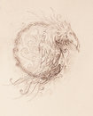 Drawing of ornamental phoenix on old paper background.