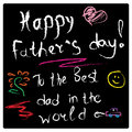 Drawing on a slate black Board with chalk greetings on father`s day