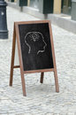 Drawing on a street restaurant menu blackboard head with light bulb drawn Stock Photography
