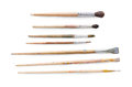 Drawing tools, set of dirty paint brushes in row