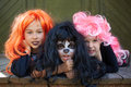 Dreadful friends portrait of three halloween girls looking at camera with grins Royalty Free Stock Photos