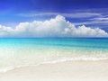 Dream beach beachscene with water reflecting the light Royalty Free Stock Photography