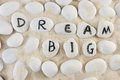 Dream big words among group of stones on the sand Royalty Free Stock Photos