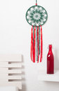 Dream catcher with green red laces Royalty Free Stock Photo