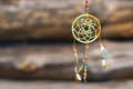Dream catcher in the wind on a wooden background, selective focus Royalty Free Stock Photo