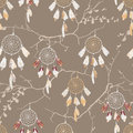 Dream catchers on the bare branches seamless vector pattern