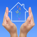 Dream house two hands and with family on blue background Stock Images