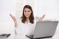 Dream job: successful smiling businesswoman sitting at desk with