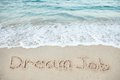 Dream Job Written On Sand By Sea Royalty Free Stock Photo