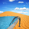 A dream to build a pool in the desert Royalty Free Stock Image