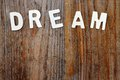 Dream word on wooden background Royalty Free Stock Photo