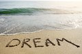 Dream word written on beach sand - positive thinking concept Royalty Free Stock Photo