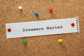 Dreamers wanted the phrase typed on a piece of paper and pinned to a cork notice board Stock Photography