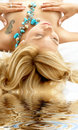 Dreaming blonde in spa Stock Images