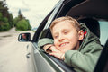 Dreaming boy look out from the car window Royalty Free Stock Photo