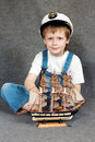 Dreaming child with the model ship. Royalty Free Stock Photo