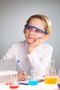 Dreaming of discovery vertical image a cute girl a scientific in the lab Stock Image