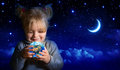 Dreaming about the future of our planet with starry night and half moon Royalty Free Stock Photo
