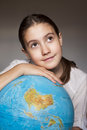 Dreaming girl with blue globe portrait Royalty Free Stock Image