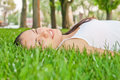 Dreaming girl lying in the grass Royalty Free Stock Photos