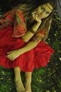 Dreaming girl sitting on the grass in the park Royalty Free Stock Photo