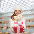 Dreaming girl in winter clothes with gift box Royalty Free Stock Photo